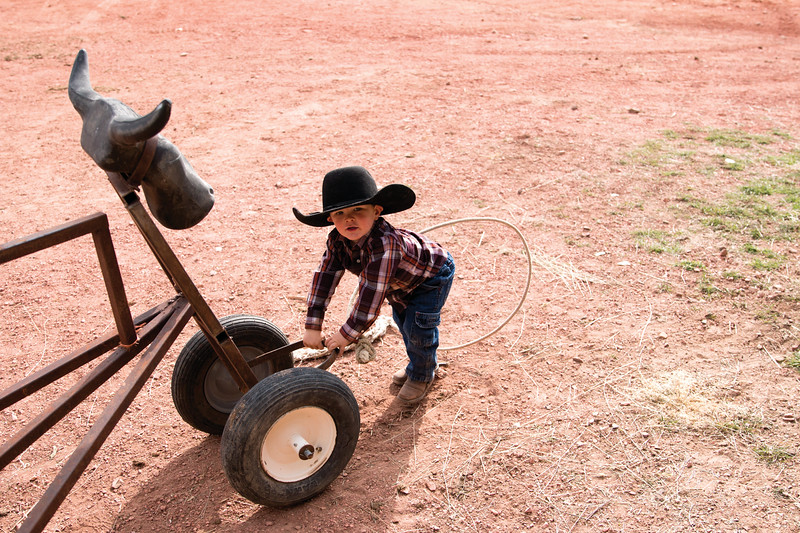 Matthew Gaston | The Sheridan Press<br>Jesse Marchant plays while the rest of his family prepares to go out to bring the herd in for the cattle transfer on the OW Ranch Thursday, Oct. 25, 2018.