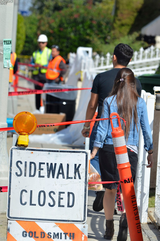 . Residents return to their home after shopping. Oil leak clean up crews in Wilmington Tuesday trying to stop  and contain oil from a ruptured pipeline on Neptune Ave. Photo by Brad Graverson/The Daily Breeze/3-18-14