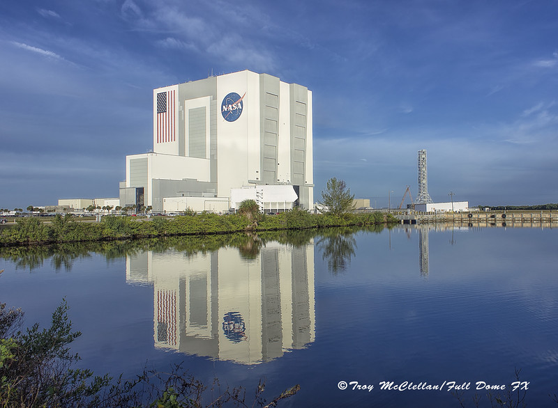 Vehicle Assembly Building Reflects into the Turn Basin
