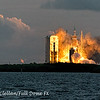 The Orion EFT-1/Delta IV Heavy clears the tower at sunrise on December 5th as seen from our viewing location on the NASA Causeway.