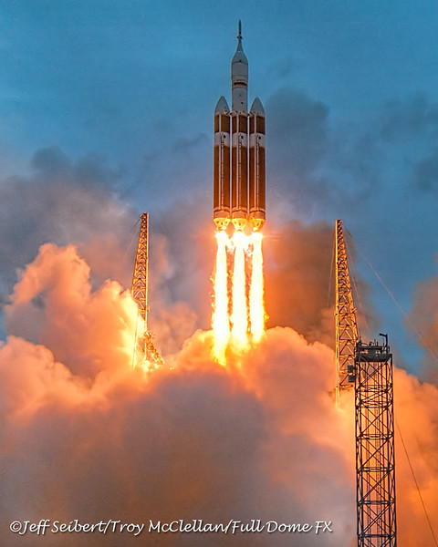 The Orion EFT-1/Delta IV Heavy clears the lightning protection towers.