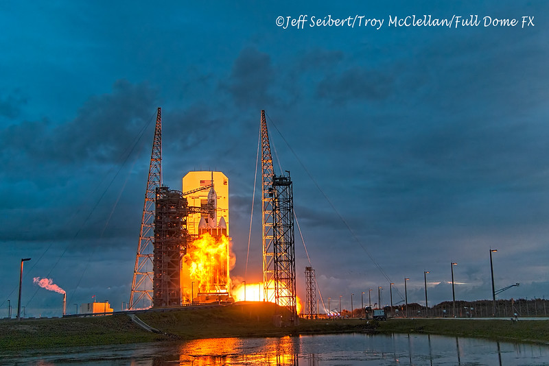 Flames shoot up the booster shortly after ignition of the Orion EFT-1/Delta IV Heavy rocket at Launch Complex 37 as seen from my remote camera.