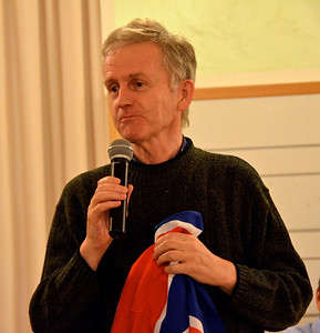 Fr. Hugh Hanley holds an English flag looking a little sad that it isn't one from Scotland?