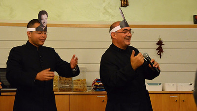 Fr. José Carlos Briñón Domínguez (right) leads the evening's entertainment.