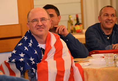 Fr. Stephen Huffstetter wrapped in the flag he just received during the welcoming activities