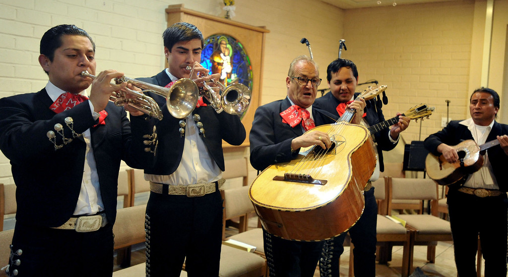 . Mariachi Real de Los Angeles help Catholics celebrate the feast day of Our Lady of Guadalupe at St. Joseph Catholic Church in Long Beach on Wednesday, Dec. 11, 2013. (Photo by Sean Hiller/Torrance Daily Breeze)