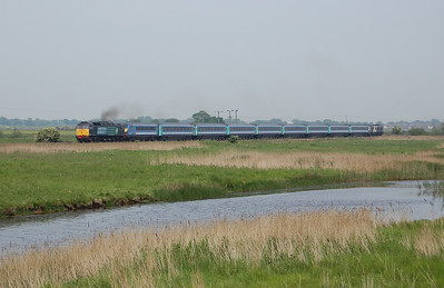 47832 approaches the divergence of the 'Acle' and 'Reedham' lines at the former Breydon Junction a mile or so outside Great Yarmouth with 5V26 1540 empty stock to Crown Point (05/06/2010)
