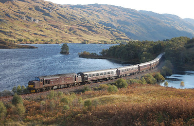 The Autumn sun peers over the hillside as 37676 'Loch Rannoch' skirts the shores of Loch Eilt with 1H86 0823 Spean Bridge-Mallaig-Fort William 'Royal Scotsman' (09/10/2010)