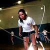 ROPE151.JPG Claim Jumpers coach and teammate Molly Metz concentrates on a high speed version of double dutch as the team practices at Louisville Elementary on Wednesday evening. Kyle Trick works the double ropes in the back. The team has qualified for the 2010 Rope Skipping World Championships and World Youth Tournament in Loughborough, UK.<br /> Photo by Paul Aiken / The Camera