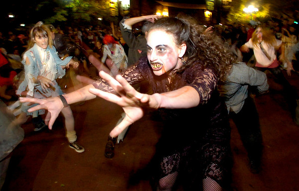 "CRAWL14.JPG Tracy Shulsinger, with a group of ""zombies"" perform  Michael Jackson's Thriller on the Pearl Street Mall on Saturday October 30, 2010. <br /> Photo by Paul Aiken / The Camera"
