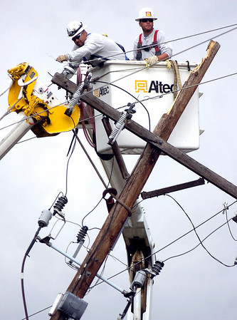 """POWER.jpg Workers prepare one of two broken power poles to be taken down in Boulder on Wednesday afternoon. A Western Disposal truck hit a power line about noon today will not be fixed for about 16 hours, according to city officials. Photo by Paul Aiken<br /> FOR A VIDEO OF THE ACCIDENT GO TO  <a href=""""http://WWW.DAILYCAMERA.COM"""">http://WWW.DAILYCAMERA.COM</a>"""