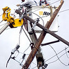 "POWER.jpg Workers prepare one of two broken power poles to be taken down in Boulder on Wednesday afternoon. A Western Disposal truck hit a power line about noon today will not be fixed for about 16 hours, according to city officials. Photo by Paul Aiken<br /> FOR A VIDEO OF THE ACCIDENT GO TO  <a href=""http://WWW.DAILYCAMERA.COM"">http://WWW.DAILYCAMERA.COM</a>"