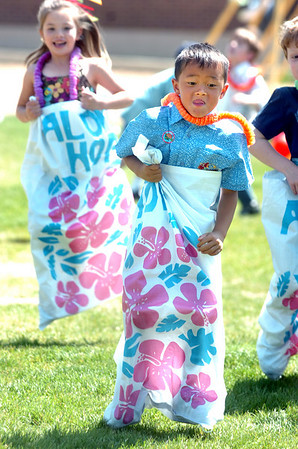 NIWOT2.jpg Kindergartner Riley Mei jumps down the course in the sack race during picnic festivities on the last day of school at Niwot Elementary on May 26, 2010. <br /> Photo by Paul Aiken / The Camera / May 25, 2010