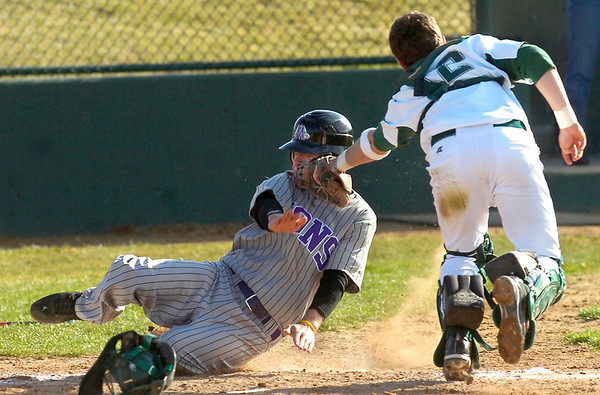 NIWOTBASEBALL7.JPG Derek Neeper is tagged out at the plate by catcher  Matt Perry during the Niwot High vs Mountain View game at Niwot High School on Wednesday April 7, 2010.<br /> Photo by Paul Aiken / The Camera