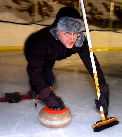 """CURLING878.JPG Steve Cser delivers a rock during play of the Nederland Curling Club at the NedRINK - Nederland Ice & Racquet Park on Monday February 15, 2010.<br /> Photo by Paul Aiken / The Camera<br /> Watch a video and see more photos of the Nederland Curling Club at  <a href=""""http://www.dailycamera.com"""">http://www.dailycamera.com</a>"""