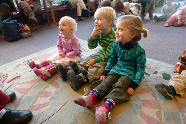 """KIDSREAD6.jpg From left to right Willow Gilmartin, 1 and 1/2, her brother Griffin Gilmartin, 3, and Lola Dean Clark listen to Melanie Howard read stories during Storytime for Kids at the Boulder Public Library Main Branch on Wednesday November 24, 2010.<br /> For more photos and a video of Storytime go to  <a href=""""http://www.dailycamera.com"""">http://www.dailycamera.com</a>"""
