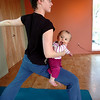 "Mommy and Me17.JPG Katie Houle holds her daughter Lia Houle, 10 months while in a pose in the Mommy and Me class at Yo Mama Yoga on Tuesday May 28, 2010. For a video and more photos of the class go to  <a href=""http://www.dailycamera.com"">http://www.dailycamera.com</a><br /> Photo by Paul Aiken /"