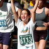 2010BOLDER542.JPG Sierra Keppler of Longmont cheers to the photographers during the Bolder Boulder on Monday May 31, 2010<br /> Photo by Paul Aiken / The Camera / May 31, 2010