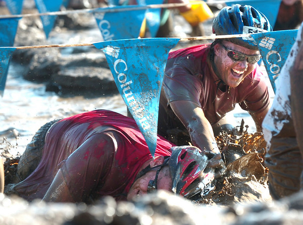 "MUDDY670.JPG Kimberly Ehlers, right shoves her partner Chris Laabs' head into the mud during the 2010 Muddy Buddy at the Boulder Reservoir on Sunday August 15, 2010. The two making up Team Awesome are from Pueblo Colorado. The Muddy Buddy is a 6.7 mile partner off-road race which finishes in the infamous mud pit. The event raises money for the Challenged Athlete's Foundation.<br /> FOR A VIDEO OF THE MUDDY BUDDY GO TO  <a href=""http://WWW.DAILYCAMERA.COM"">http://WWW.DAILYCAMERA.COM</a><br /> Photo by Paul Aiken / The Camera"