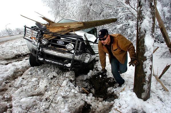 snow3.jpg Nick Holzwarth of Marv's Towing works to get a truck off the side of US 36 Wednesday morning.<br /> Photo by Paul Aiken / The Daily Camera
