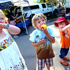 PEACHES.jpg From left to right Leah Nibarger, 6, Jackson McCool, 6, and Bryce Nibarger, 4, all enjoy fresh peaches at the Boulder Farmers' Market on Wednesday September 15, 2010.<br /> Photo by PAUL AIKEN  / The Camera / September 15, 2010
