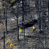 FOURMILE34.JPG Firefighters work a hillside off Logan Mill Road in Fourmile Canyon Monday September 13, 2010.<br /> Photo by Paul Aiken