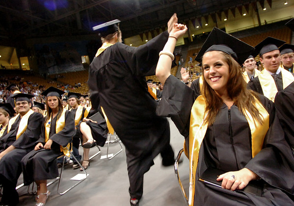 """MONARCH4.JPG Lauren Bacon high-fives students leaving the diploma stage during the Monarch High School Commencement at the Coors Events Center on the CU Boulder Campus on Saturday May 22, 2010.<br /> For more photos and a video of the graduation go to  <a href=""""http://www.dailycamera.com"""">http://www.dailycamera.com</a><br /> Photo by Paul Aiken / The Camara /"""