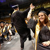 "MONARCH4.JPG Lauren Bacon high-fives students leaving the diploma stage during the Monarch High School Commencement at the Coors Events Center on the CU Boulder Campus on Saturday May 22, 2010.<br /> For more photos and a video of the graduation go to  <a href=""http://www.dailycamera.com"">http://www.dailycamera.com</a><br /> Photo by Paul Aiken / The Camara /"