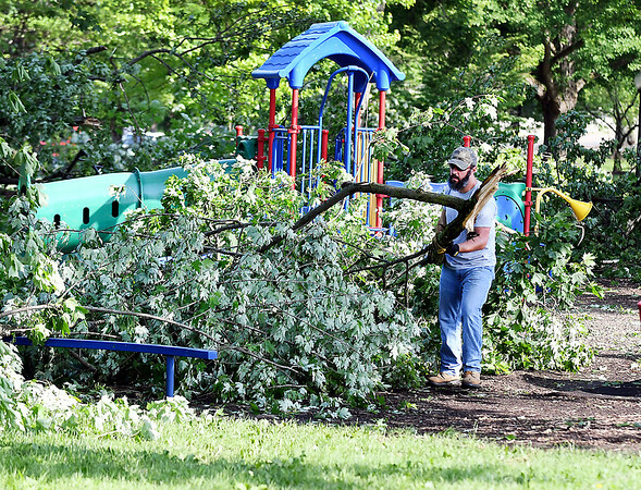 John P. Cleary   The Herald Bulletin <br /> Cleanup started Tuesday morning on removing all the downed and damaged trees in Falls Park from Monday's tornado.