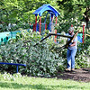 John P. Cleary | The Herald Bulletin <br /> Cleanup started Tuesday morning on removing all the downed and damaged trees in Falls Park from Monday's tornado.