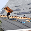 John P. Cleary | The Herald Bulletin <br /> Tornado cleanup starts in the Pendleton area after Monday's storms. Repairs begin on the roof of Pendleton First United Methodist Church.