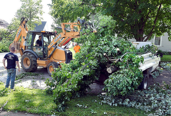 John P. Cleary | The Herald Bulletin <br /> Tornado cleanup starts in the Pendleton area after Monday's storms. Crews were out cleaning up the storm damage from the side streets throughout Pendleton, here clearing the intersection of High and West Streets.
