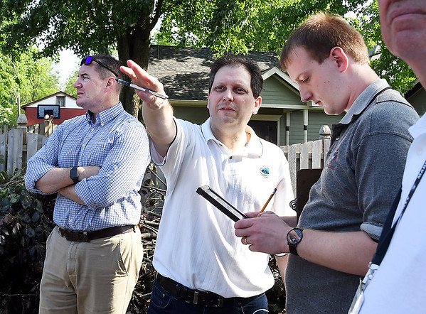 John P. Cleary   The Herald Bulletin <br /> Jason Buma, center, of the National Weather Service, surveys the damage in Pendleton Tuesday morning. The survey team confirmed that it was a tornado that caused the damage.
