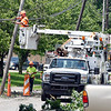 John P. Cleary | The Herald Bulletin <br /> Tornado cleanup starts in the Pendleton area after Monday's storms. Power crews work to restore power along Water Street Tuesday afternoon.
