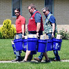 John P. Cleary | The Herald Bulletin <br /> Tornado cleanup starts in the Pendleton area after Monday's storms. Lowes employees walk through the neighborhoods handing out cleanup kits that they have donated to help the cleanup effort.