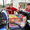 Addison Farrer of Pendleton spent her 20th birthday passing out free water, hot dogs and chips to Pendleton residents with Sam Denny, Missy Denny. The three were joined by others from the local restaurant, The Stable.
