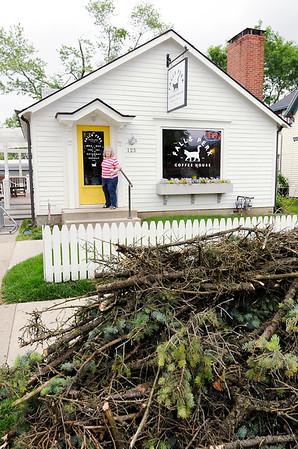 Don Knight | The Herald Bulletin<br /> Dorothy Moneyhun leaves Falls Perk on Wednesday. Downtown shops began to reopen as power was restored and streets were opened.