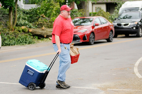 Don Knight | The Herald Bulletin<br /> Bert Williams with the Salvation Army brings lunches and cold drinks to volunteers cleaning downed trees in Pendleton on Wednesday after the town was hit by a tornado on Memorial Day.