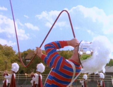 Artie celebrates with a homemade instrument