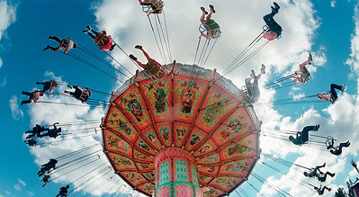 Fans of the North Carolina State Fair go for a high flying spin on the large swing ride as enjoy Carolina blue skies and great weather. (Photo by Jerome Sturm)