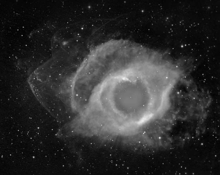 "Helix nebula showing outer bow shocks in H-alpha. 34 hrs 2x2 binned, in 1 hr subs, plus 4 hrs unbinned for core detail. Field  43 min arc wide (three overlapping panels). Aspen CG16M on 20"" PlaneWave. The very faintest bow shocks toward top right have rarely, if ever been photographed before."