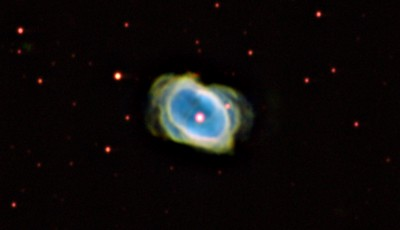 "Eight Burst Nebula, NGC 3132, a tiny (90 "" arc) planetary in Antlia.  H-alpha: Green, OIII: Blue, SII: Red. 90 min each.  There is  a very prominent white egg-shaped bubble, flooded with OIII emission, and surrounded by an irregular beard stronger in H-alpha and SII. More difficult to see is an almost edge-on equatorial band.  Aspen CG16M on 20"" PlaneWave. Altitude 660 metres.  This is probably not the best set-up for viewing tiny bright structures, as we are strongly limited by seeing."