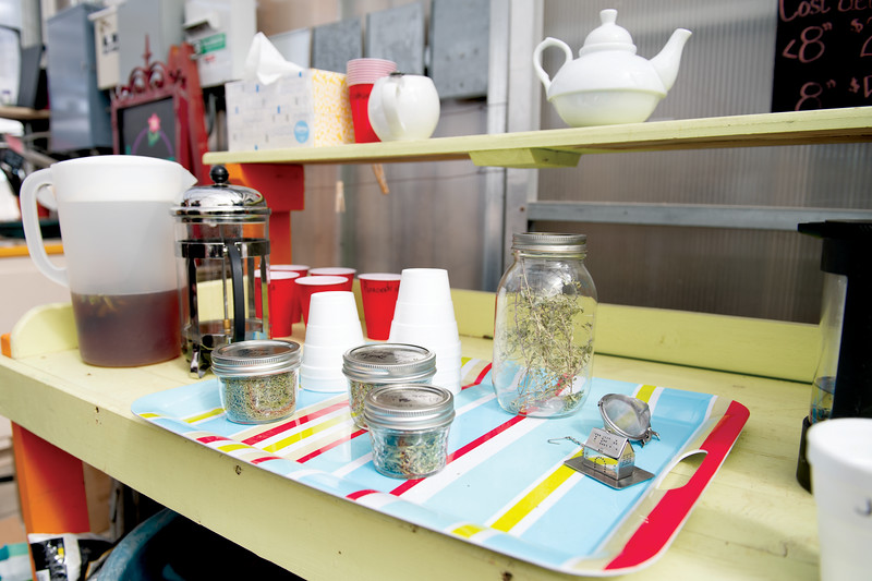 Matthew Gaston | The Sheridan Press<br>A small tea station was set up in the greenhouse at Landon's Greenhouse, Nursery and Landscaping so participants in the Plant a Tea Garden Workshop could sample teas made from the herbs they had planted in their tea gardens Saturday, March 23, 2019.
