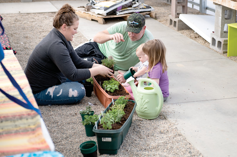 Matthew Gaston | The Sheridan Press<br>The Diamond family, from left, Cassie, Jamie, 9-month-old Brooklyn and 3-year-old Maddie get their hands dirty at Landon's Greenhouse, Nursery and Landscaping during the Plant a Tea Garden Workshop Saturday, March 23, 2019.