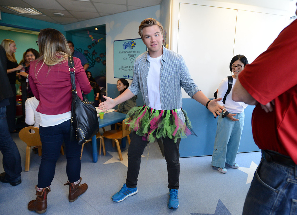 . Toyota Grand Prix of Long Beach Pro/Celebrity Race participant actor Brett Davern, dressed up,  as he and other participants met some of the children at Miller Children�s Hospital at Long Beach Memorial Medical Center,  who will benefit from the proceeds generated by the 38th annual Toyota Grand Prix of Long Beach Pro/Celebrity Race.     Long Beach Calif., Thursday, April 10,  2014.   (Photo by Stephen Carr / Daily Breeze)