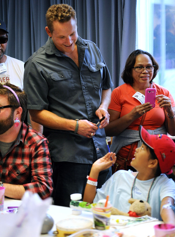 . Toyota Grand Prix of Long Beach Pro/Celebrity Race participant actor Cole Hauser, with Isabel,  as participants meet some of the children at Miller Children�s Hospital at Long Beach Memorial Medical Center,  who will benefit from the proceeds generated by the 38th annual Toyota Grand Prix of Long Beach Pro/Celebrity Race.     Long Beach Calif., Thursday, April 10,  2014.   (Photo by Stephen Carr / Daily Breeze)