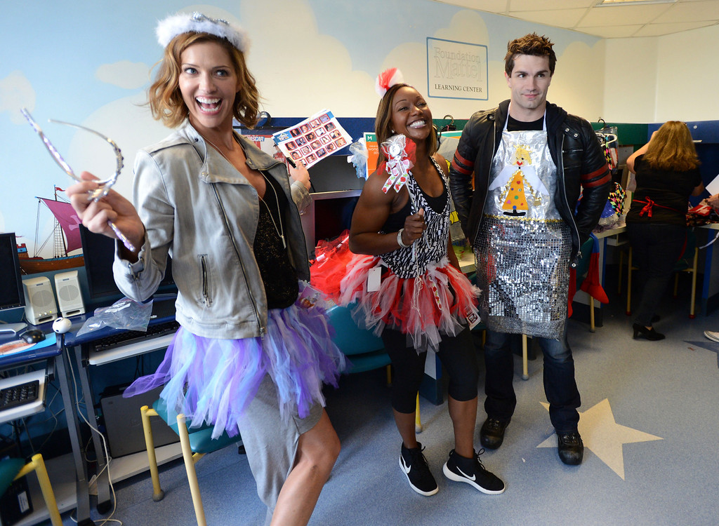 . Toyota Grand Prix of Long Beach Pro/Celebrity Race participants actress Tricia Helfer,left, olympic sprinter Carmelita Jeter,center, and actor Sam Witwer dressed up in costumes as they meet some of the children at Miller Children�s Hospital at Long Beach Memorial Medical Center,  who will benefit from the proceeds generated by the 38th annual Toyota Grand Prix of Long Beach Pro/Celebrity Race.     Long Beach Calif., Thursday, April 10,  2014.   (Photo by Stephen Carr / Daily Breeze)