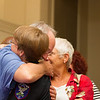 Allen Spalt hugs Carolyn Hutchison at the reception