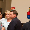 Brian Hutchison talks with Susie and Steve Hutchison at Carolyn's retirement reception