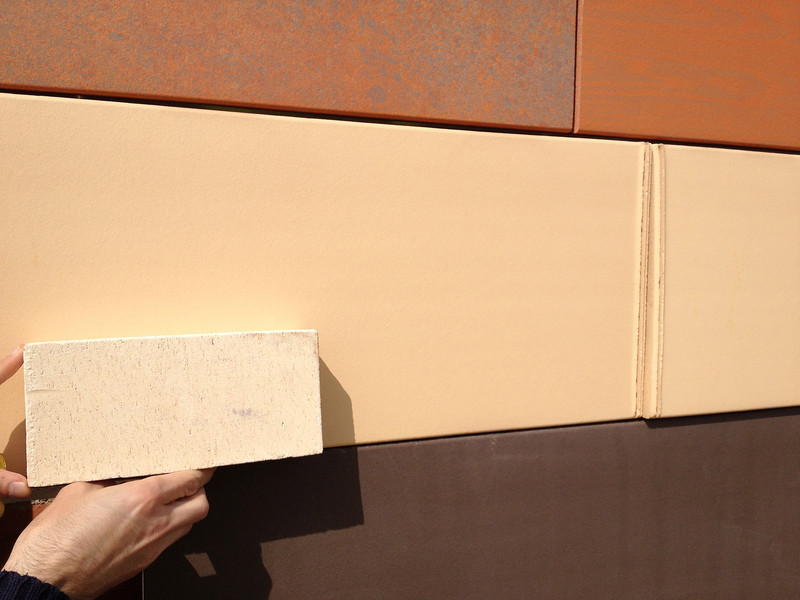 "small sample = new Revel ""stone"" color<br /> tile in back:  current ""Champagne"" color"